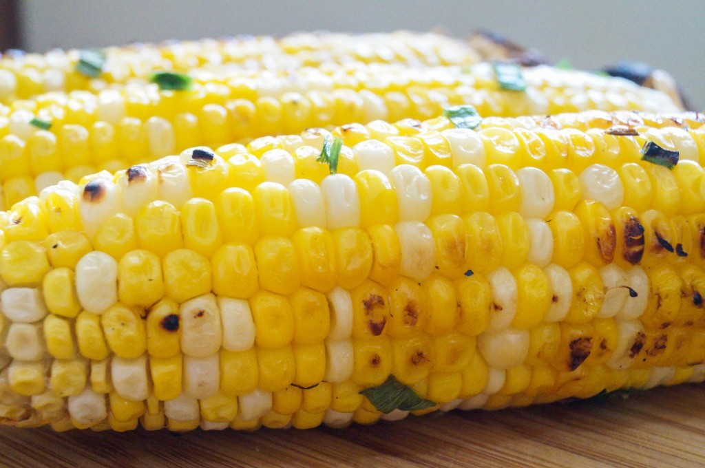 the sauce on the corn as you turn it on the grill or hold the corn ...