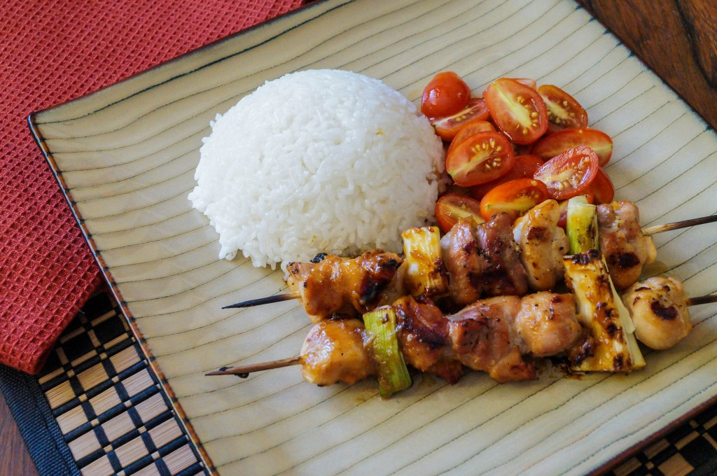 yakitori is a japanese grilled chicken dish prepared by skewering bite ...