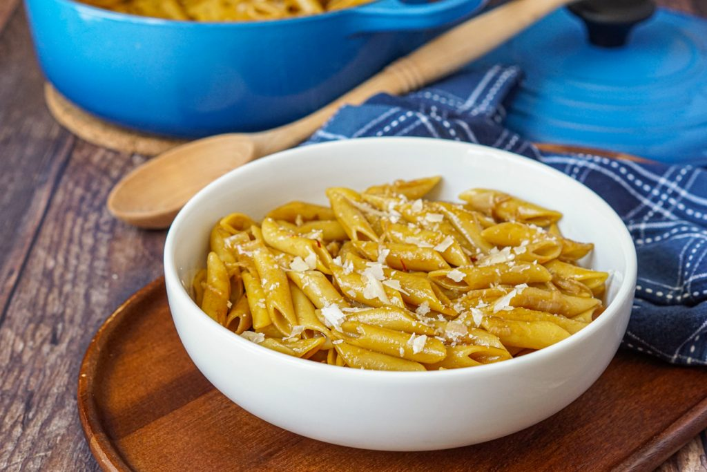 Penne Gialle (Penne with Saffron) in a bowl with cheese