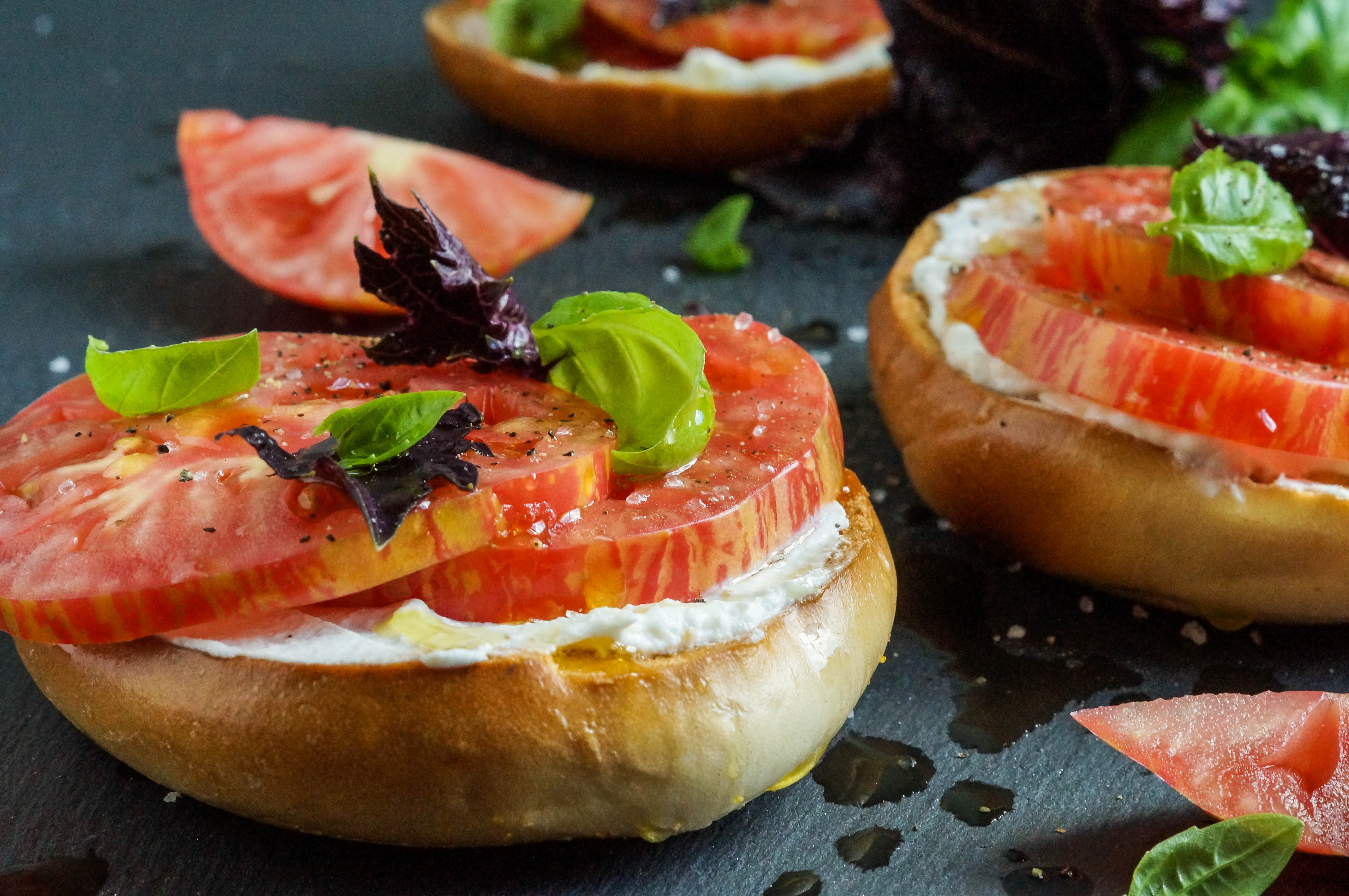 Crisp Toasted Bagel with Fromage Blanc, Tomato, Seas Salt, and Basil (1 of 3)