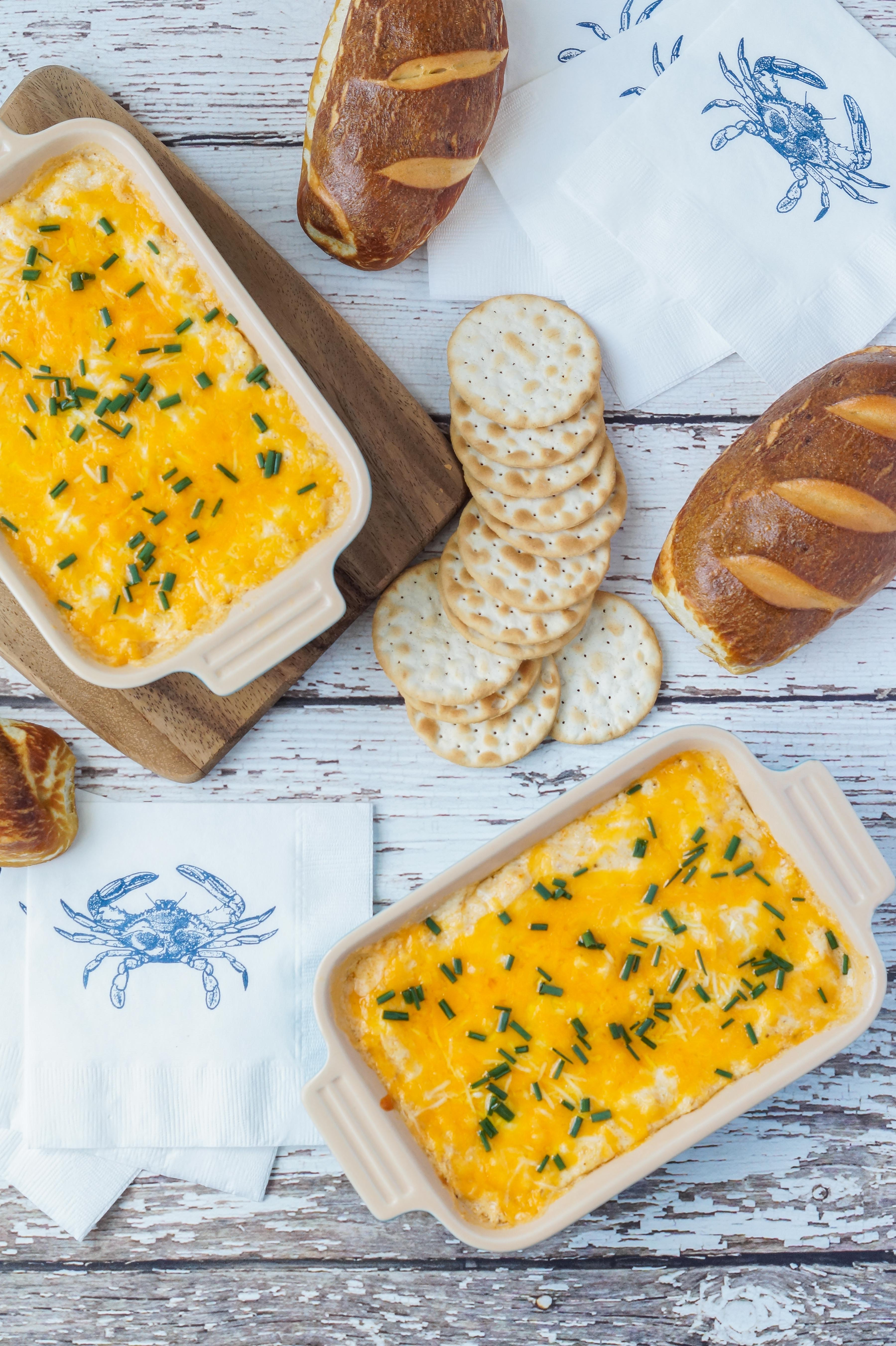 Maryland Crab Dip in a dish with crackers and bread