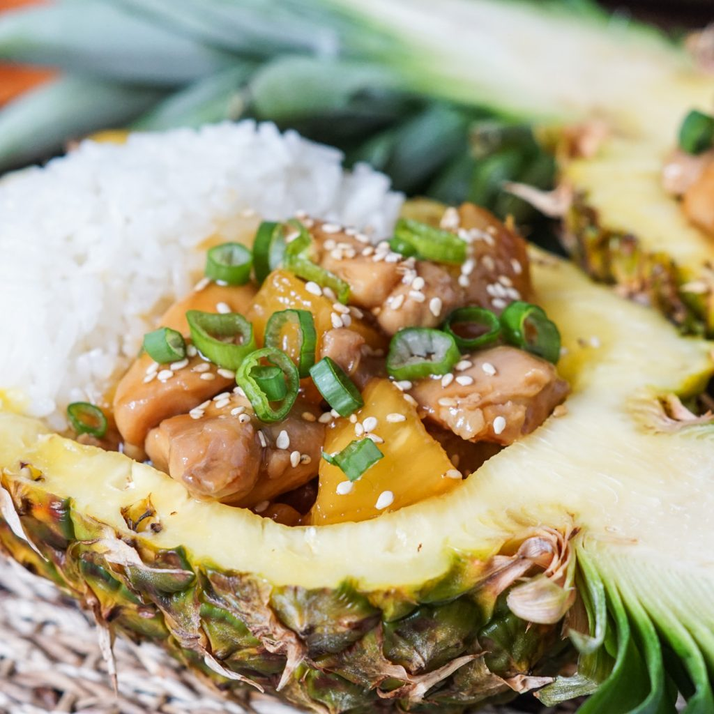 Pineapple Teriyaki Chicken served in a pineapple boat