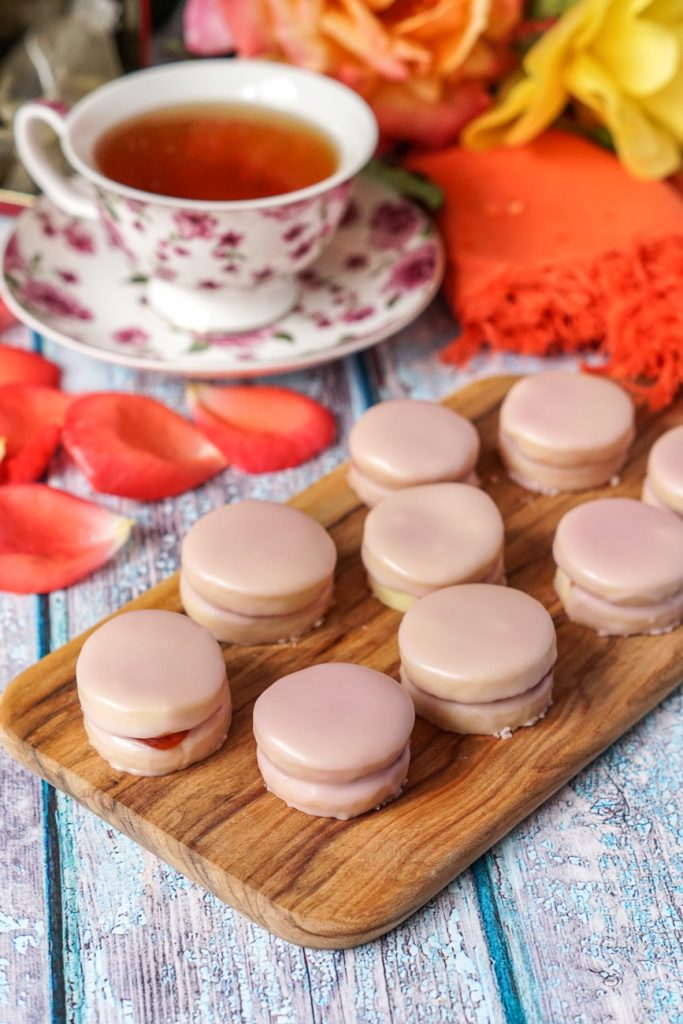 Napolitaines (Mauritian Sandwich Cookies) covered in a pink glaze