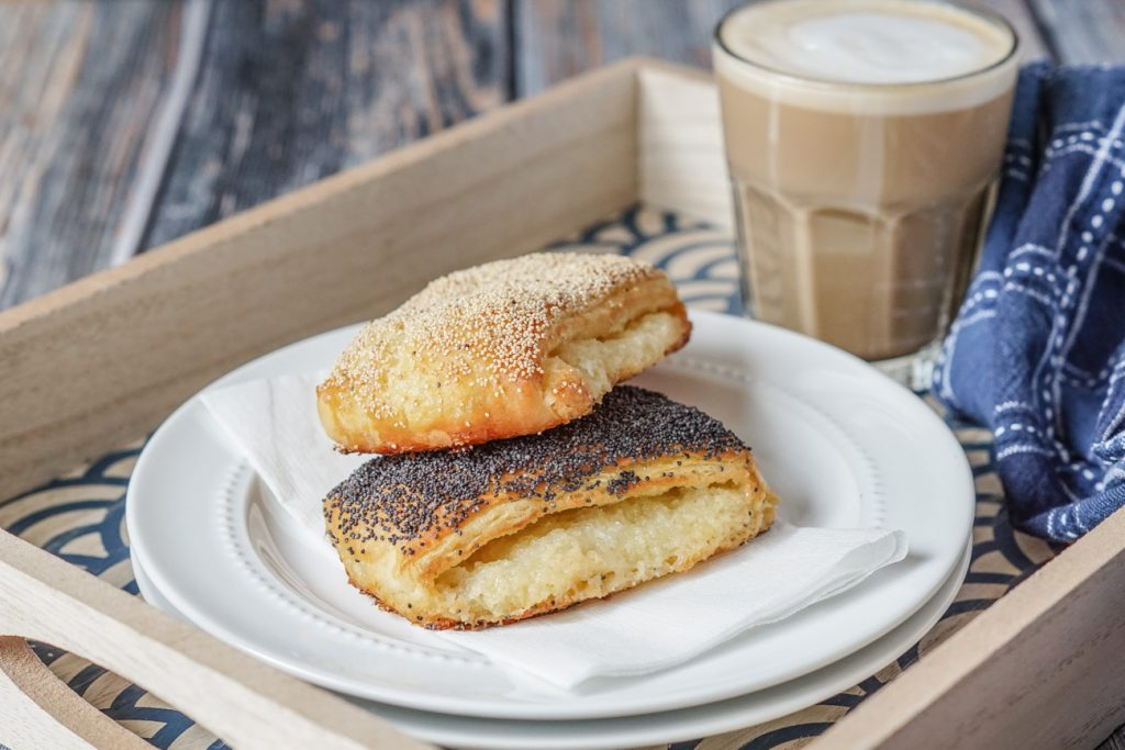 Tebirkes (Danish Poppyseed Pastries) on a plate with coffee