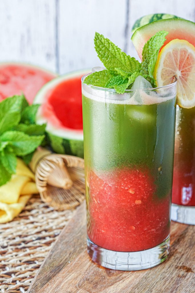 Iced Watermelon Matcha in a glass with mint and lemon